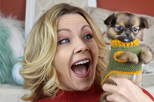 Kelly Swift of Sweetie Pie Pets holding a Chihuahua puppy in a sweater